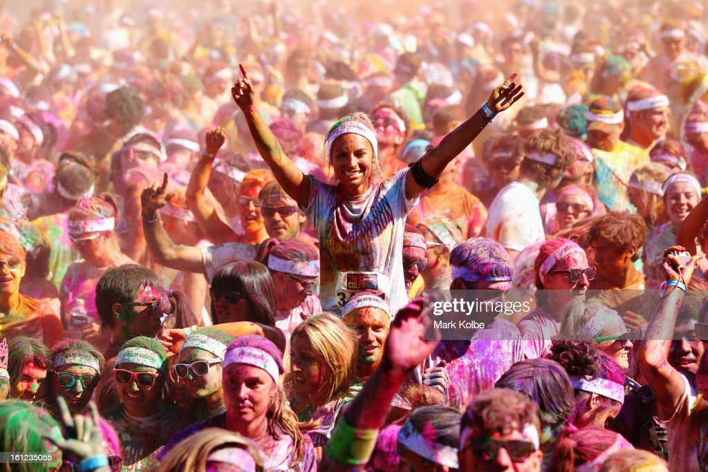 Competitors enjoy a DJ set and throw packets of coloured powder after finishing the Colour Run at Sydney Olympic Park on February 10, 2013 in Sydney, Australia.