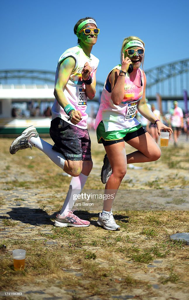 Competitors enjoy the Color Run on July 21, 2013 in Cologne, Germany.