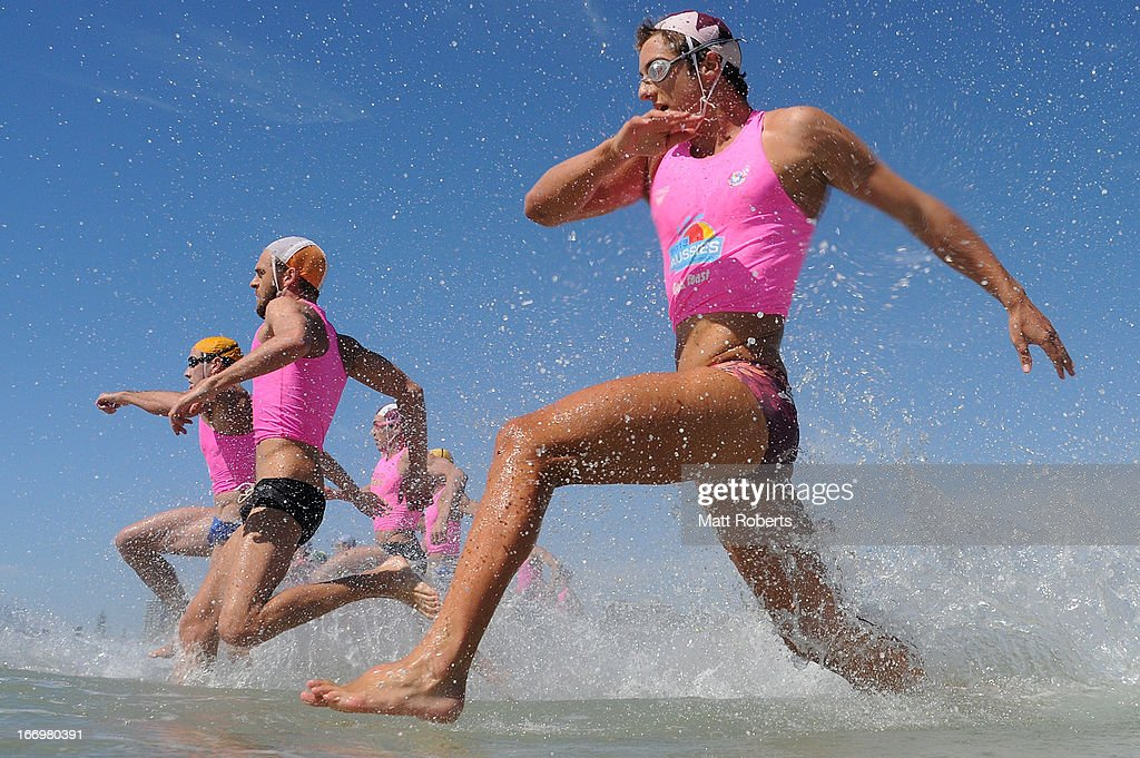 Competitors enter the water during day three of the 2013 Australian National Surf Lifesaving Titles on April 19, 2013 on the Gold Coast, Australia.