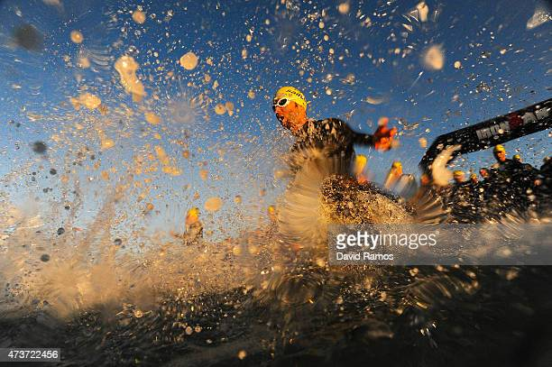 Competitors enter the water during Ironman 703 on May 17 2015 in Barcelona Spain