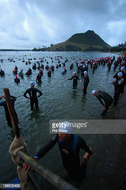 Competitors enter the water for the start of the 2012 Port of Tauranga Half Ironman on January 7 2012 in Tauranga New Zealand