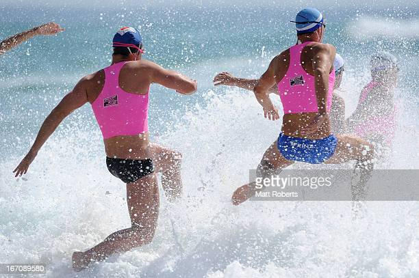 Competitors enter the water in the Open Men's Surf Race during the 2013 Australian National Surf Lifesaving Titles on April 20 2013 on the Gold Coast...