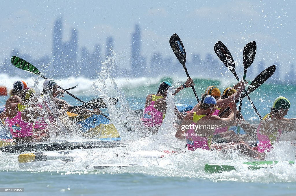 Competitors enter the water in the Under 19 Single Ski final during the 2013 Australian National Surf Lifesaving Titles on April 21, 2013 on the Gold Coast, Australia.