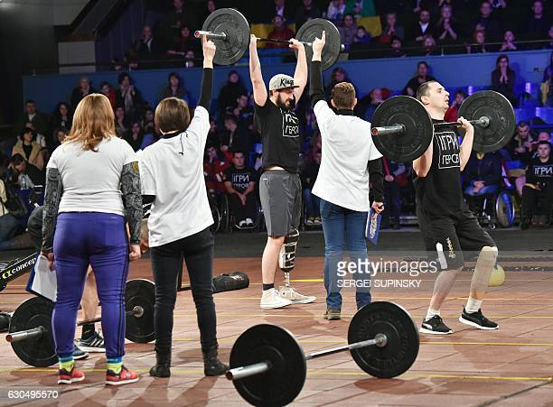 Competitors exercise as they take part in the final competition of the 'Games of the Heroes' crossfit challenge in Kiev on December 24 2016 Some...