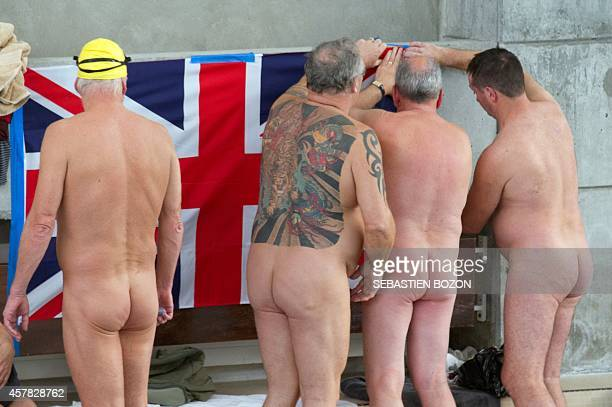 Competitors fix a Great Britain's flag during a naturist swimming championship on October 25 2014 in Mulhouse eastern France AFP PHOTO / SEBASTIEN...