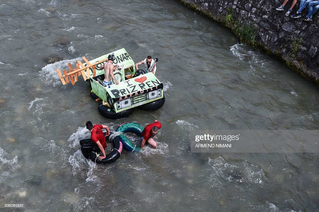 Competitors float on tractor inner tubes during a alternative sport rubber competition titled 'Bunar Fest' on May 29, 2016 on the Bistrica river in the southern Kosovo town of Prizren / AFP / ARMEND