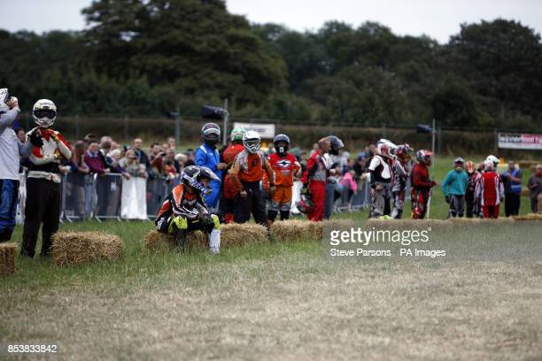 Competitors get ready for a Le Mans start in the British Lawn Mower Racing Association 12 hour British Lawn mower endurance race near Billingshurst...