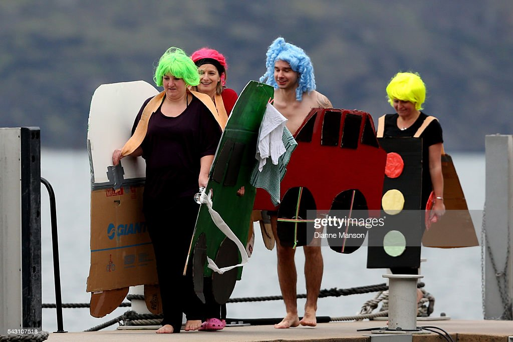 Competitors get ready to dive off the wharf during the American Express Queenstown Winter Festival Hits 90.4 Birdman competition on June 26, 2016 in Queenstown, New Zealand.
