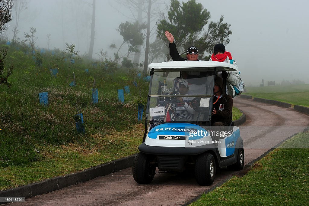 Competitors head back to the club house as a fog bank roles in causing another weather delay during the Madeira Islands Open - Portugal - BPI at Club de Golf do Santo da Serra on May 10, 2014 in Funchal, Madeira, Port gal.