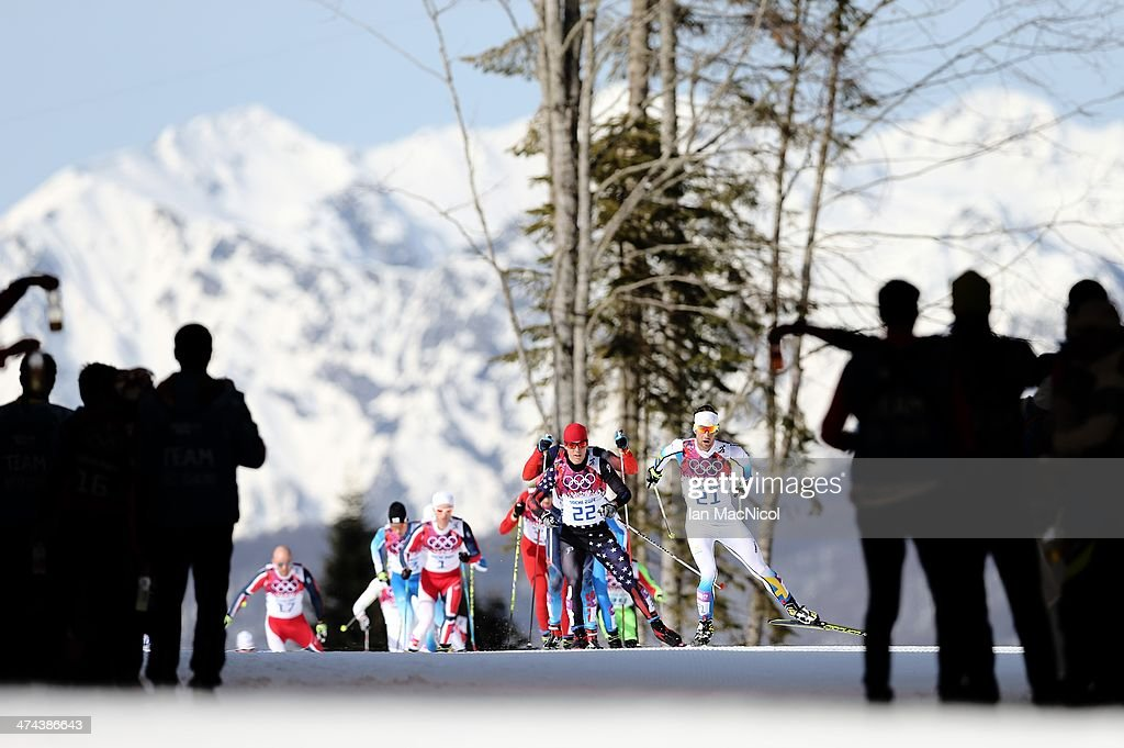 Competitors head towards a feed station as they compete in The Men's 50km Mass Start on Day 16 of the Sochi 2014 Winter Olympics at Laura Cross-country Ski & Biathlon Center on February 23, 2014 in Sochi, Russia.