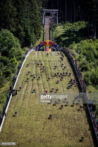 Competitors in a mens heat make their way up the 400 metre skijump at Hochfirstschanze during the Red Bull 400 World Championship at TitiseeNeustadt...