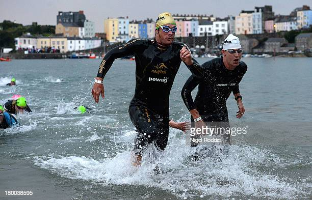 Competitors in action during the swim stage of the Ironman Wales triathlon on September 82013 in Tenby Wales