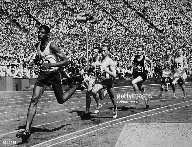 Competitors in Heat 2 of the 800 metres semifinal at the Olympic Games at Wembley London It was won by Ingvar Bengtsson of Sweden from Arthur Wint of...