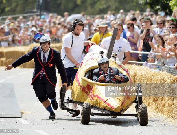 A competitors in one of 70 gravity powered vehicles is helped after crashing on a jump during The Red Bull Soapbox Race at LondonOtildes Alexandra...