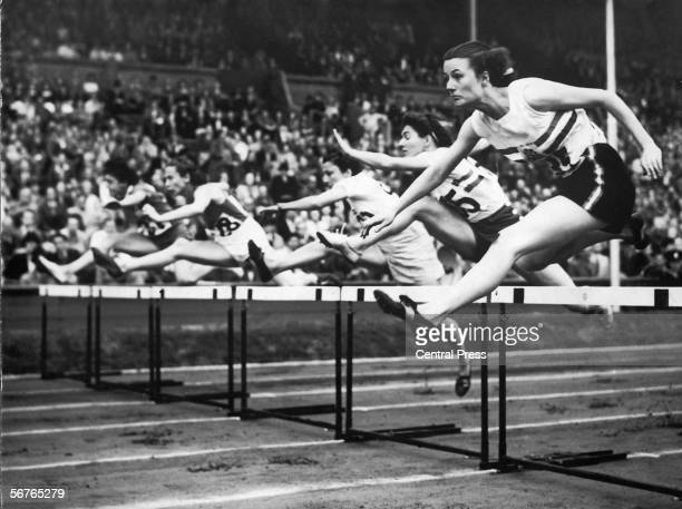 Competitors in one of the heats in the 80Metres Hurdles at the London Olympics Wembley Stadium London 3rd August 1948 Left to right J MagninLamouche...