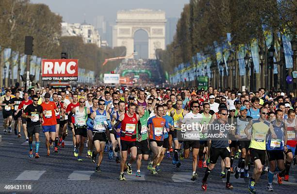 Competitors in the 39th Paris Marathon run down the Champs Elysees in Paris on April 12 2015 AFP PHOTO / THOMAS SAMSON