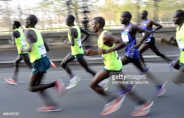 Competitors in the 39th Paris Marathon run past in Paris on April 12 2015 AFP PHOTO / STEPHANE DE SAKUTIN