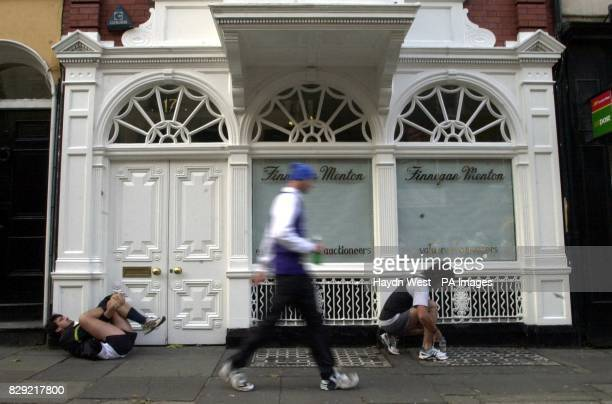 Competitors in the Adidas Dublin Marathon limber up prior to the start in Dublin Republic of Ireland Athletes from more than 50 countries were taking...