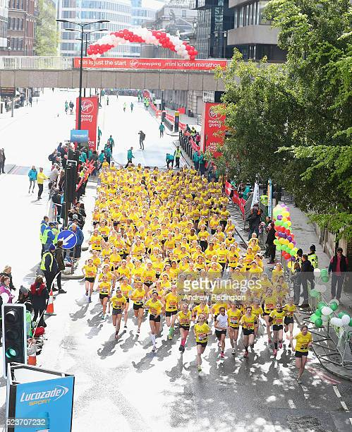 Competitors in the Girls Under 15s are pictured at the start of The Virgin Money Giving Mini London Marathon on April 24 2016 in London England