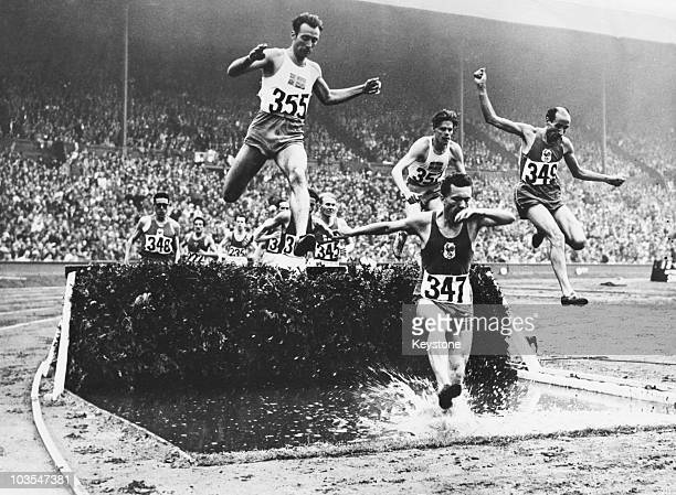Competitors in the men's 3000 metre steeplechase at the Olympic Games Wembley Stadium London 5th August 1948 The first four are Roger Chesneau of...