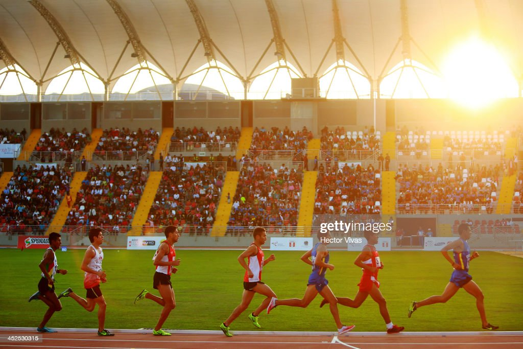 Competitors in the men's 5,000m final as part of the XVII Bolivarian Games Trujillo 2013 at Chan Chan Stadium on November 29, 2013 in Trujillo, Peru.
