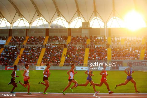 Competitors in the men's 5000m final as part of the XVII Bolivarian Games Trujillo 2013 at Chan Chan Stadium on November 29 2013 in Trujillo Peru