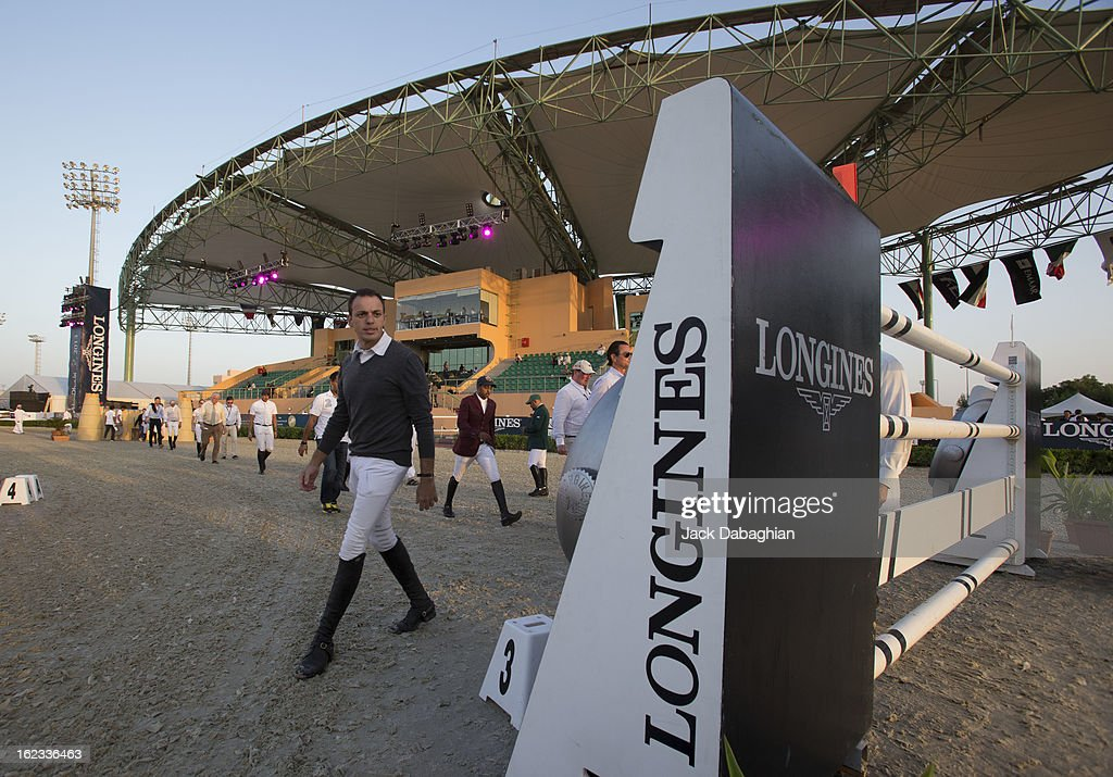 Competitors in the President of the UAE Showjumping Cup - Furusyiah Nations Cup Series presented by Longines check the track on February 21, 2013 in Al Ain, United Arab Emirates.