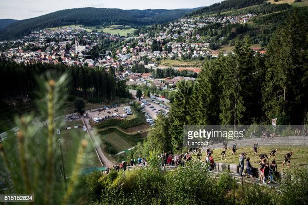 Competitors in the women`s final make their way up the 400 metre skijump at Hochfirstschanze during the Red Bull 400 World Championship at...