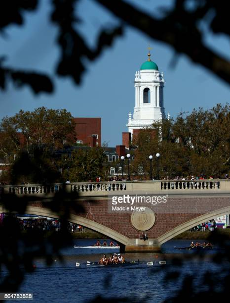 Competitors in the Women's Senior Master Fours row under the John W Weeks bridge during the Head of the Charles Regatta on October 21 2017 in Boston...