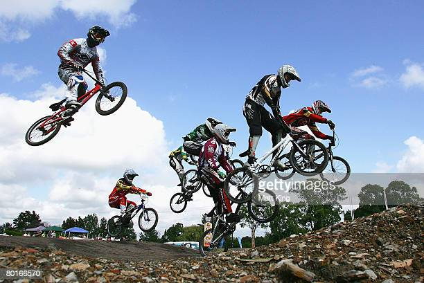 Competitors jump during a moto round of the elite mens during ranking round nine of the 2008 UCI BMX Oceania series at Penrith BMX Club on March 8...