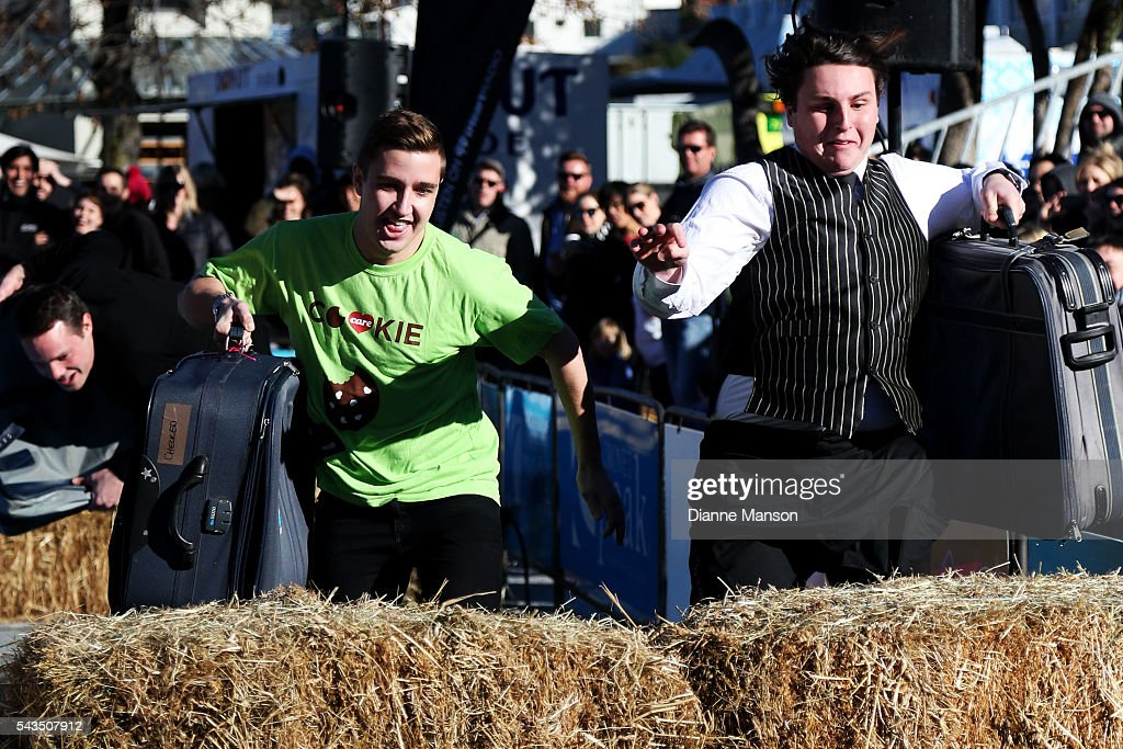 Competitors jump the hay bale in the Hospitality race during the Queenstown Winter Festival on June 29, 2016 in Queenstown, New Zealand.