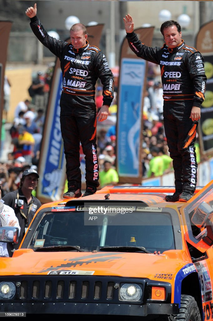 US competitors Kellon Walch(L) and Robby Gordon wave atop of their Hummer during the departure ceremony of the fifth South American edition of the Dakar Rally 2013 in Lima on January 5, 2013.