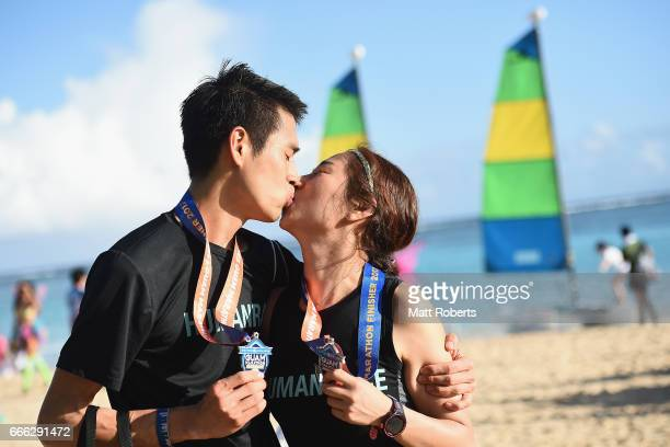 Competitors kiss after finishing the United Airlines Guam Marathon 2017 on April 9 2017 in Guam Guam