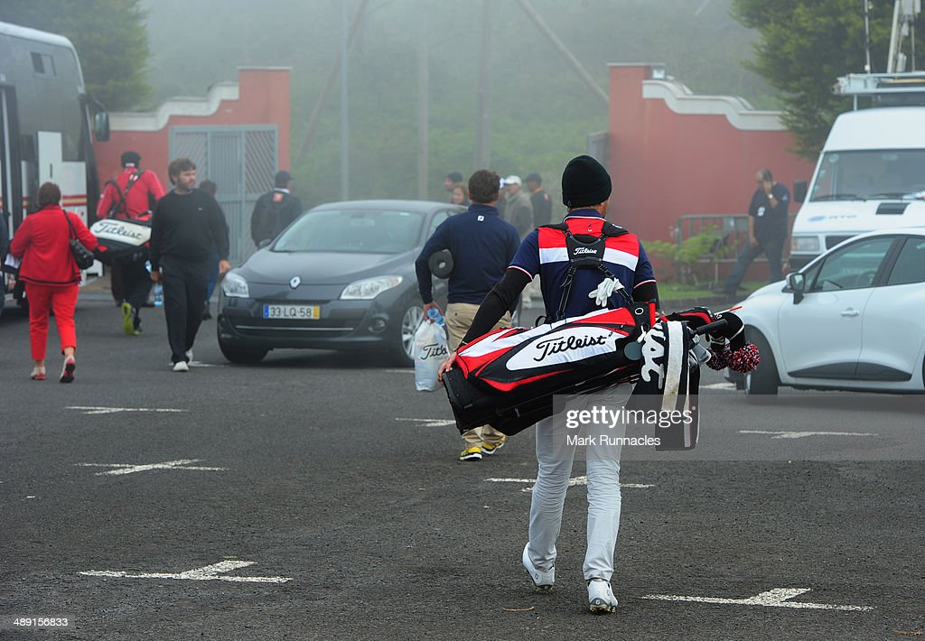 Competitors leave the golf course as play is abandoned for the day because of poor weather conditions during the Madeira Islands Open - Portugal - BPI at Club de Golf do Santo da Serra on May 10, 2014 in Funchal, Madeira, Port gal.