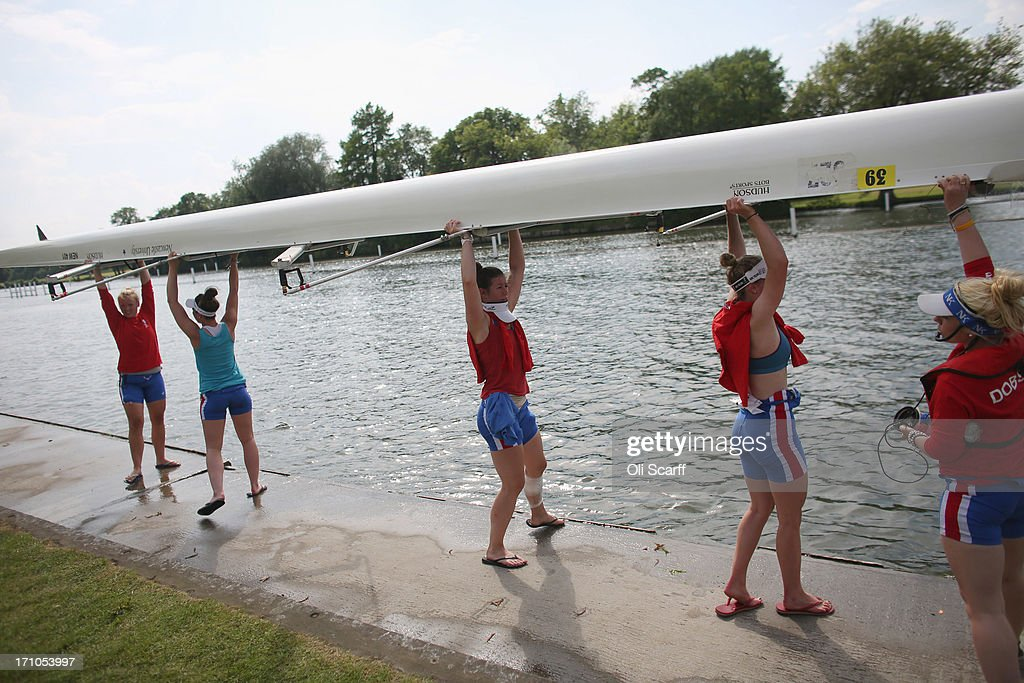 Competitors lift their boat out of the water at the end of the first day of the Henley Women's Regatta on June 21, 2013 in Henley-on-Thames, England. The annual 3-day event, which has taken place since 1988, sees female crews from the UK and abroad compete on the Henley Royal Regatta course. In the past, several female rowers who have enjoyed success at the Henley Women's Regatta have gone on to win Olympic medals in the sport.