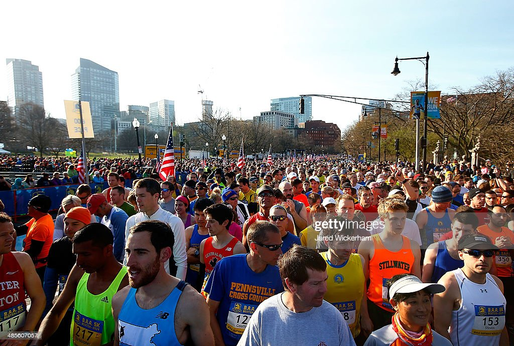Competitors line up at the start line of the 2014 B.A.A. 5K on April 19, 2014 in Boston, Massachusetts.