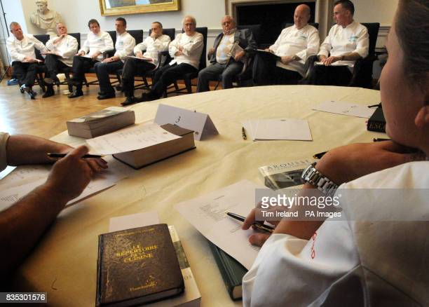 Competitors listen to the judges during the final of the Roux Scholarship at the Mandarin Oriental Hotel in London