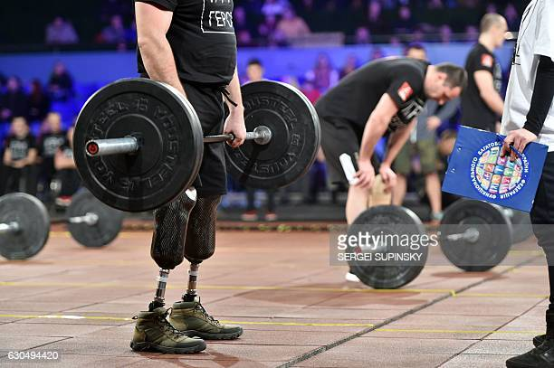 Competitors make exercises as they take part in the final competition for CrossFit Games called 'Games of the Heroes' in Kiev on December 24 2016...