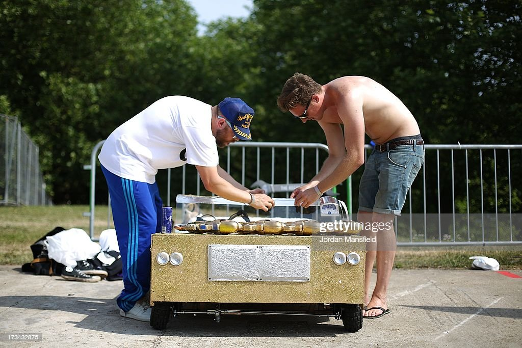 Competitors make final touches to their soapbox racer ahead of the start of the races at Alexandra Palace on July 14, 2013 in London, England. The Red Bull Soapbox Race returned to London after nine years and encourages competitors to build and race their own homemade soapboxes down a hill.
