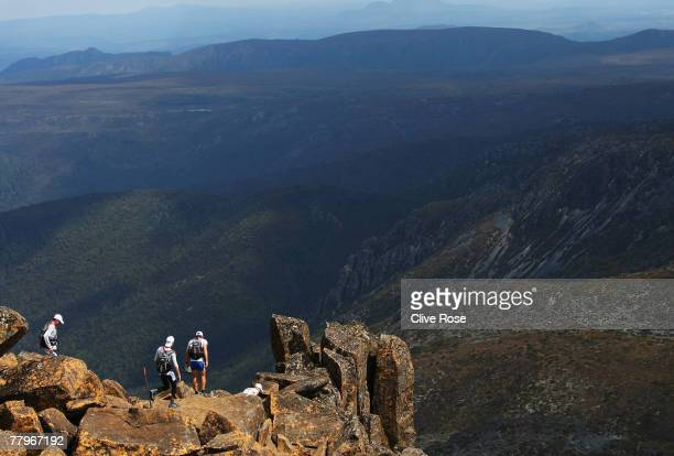 Competitors make their way down from the summit of Cradle Mountain during the hiking section on day one of the Mark Webber Pure Tasmania Challenge...