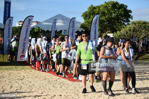 Competitors make their way to the beach after the United Airlines Guam Marathon 2017 on April 9 2017 in Guam Guam