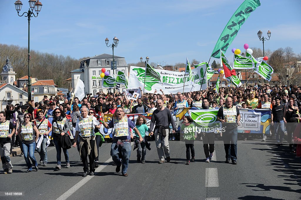 Competitors of the 18th Korrika, a 10 day relay race aimed at raising funds for the teaching of the Basque language, walk toward the finish area, on March 24, 2013 in Bayonne, south western France.