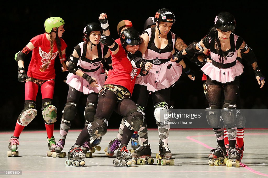 Competitors of the Screamin' Assault Sirens and the Beauty School Knockouts competes during a Mini Bout of the Sydney Roller Derby League on May 11, 2013 in Sydney, Australia. The wildest thing on eight-wheels, these 'Warriors' of Roller Derby are jamming a blend of athletisim and pop culture through bumps, bruises, hip-whips, tattoos, fishnets and big characters as the fastest growing Women's sport on the planet, with over 1200 amatuer leagues worldwide. Originated in the mid 1930's as endurance skating, the modern revival of Roller Derby early in the 21st century can be artibuted to an all-female participation who share a strong 'do it yourself' ethic.