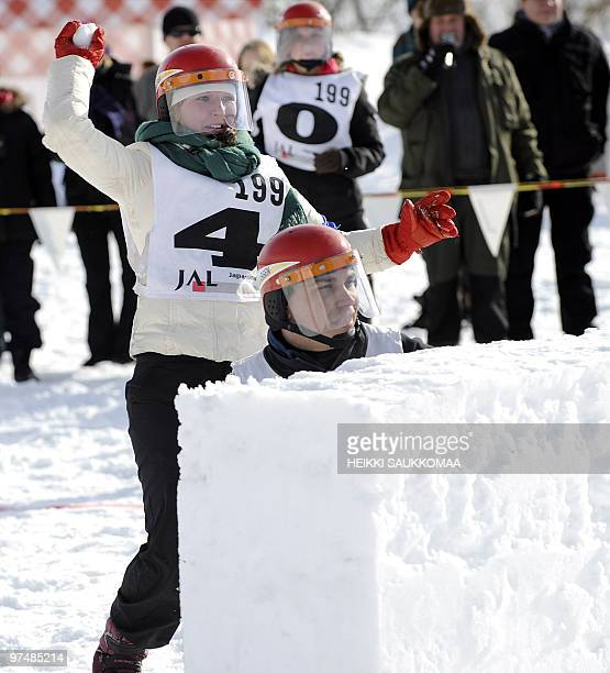 Competitors of the Skadam team fight with snowballs during the Yukigassen Snowbattle 2010 the Finnish Championships in Helsinki on March 6 2010 AFP...