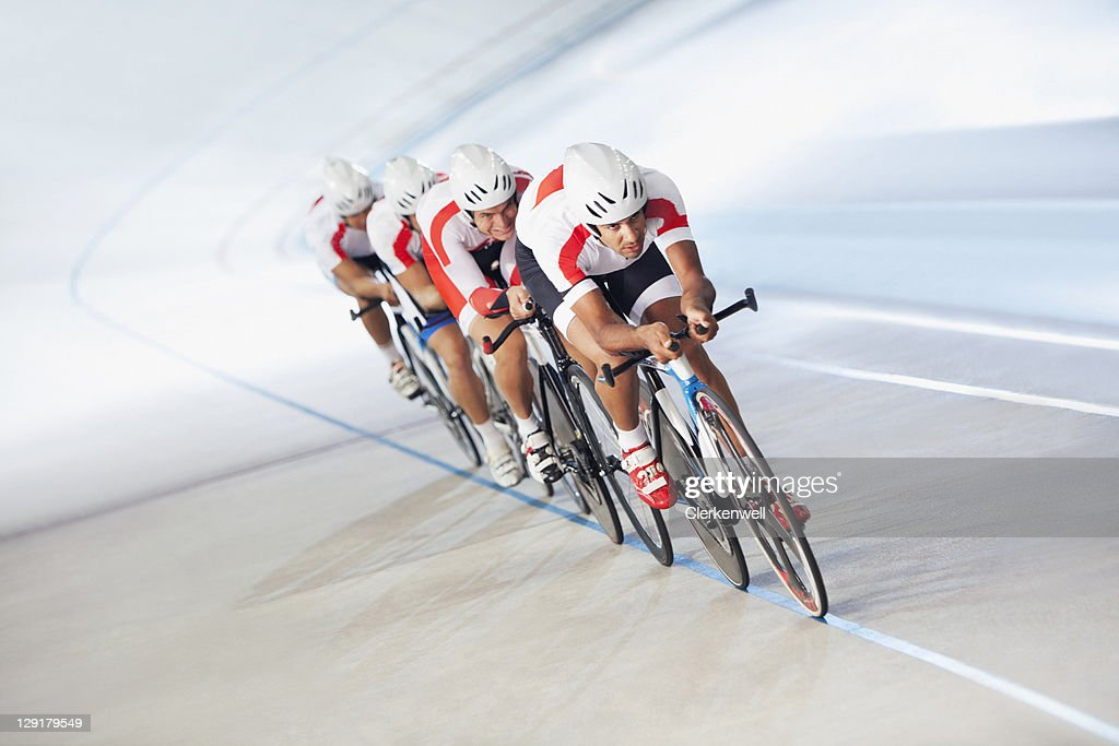 Competitors on cycling track : Stock Photo