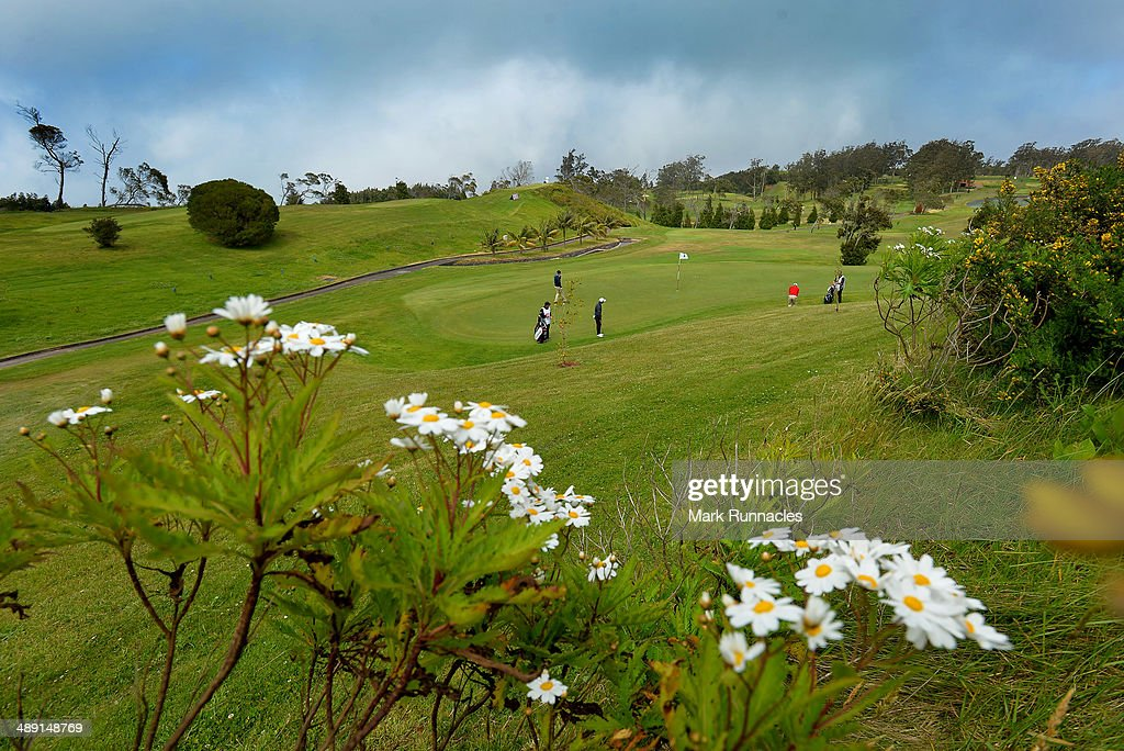 Competitors on the picturesque 16th green during the Madeira Islands Open - Portugal - BPI at Club de Golf do Santo da Serra on May 10, 2014 in Funchal, Madeira, Port gal.