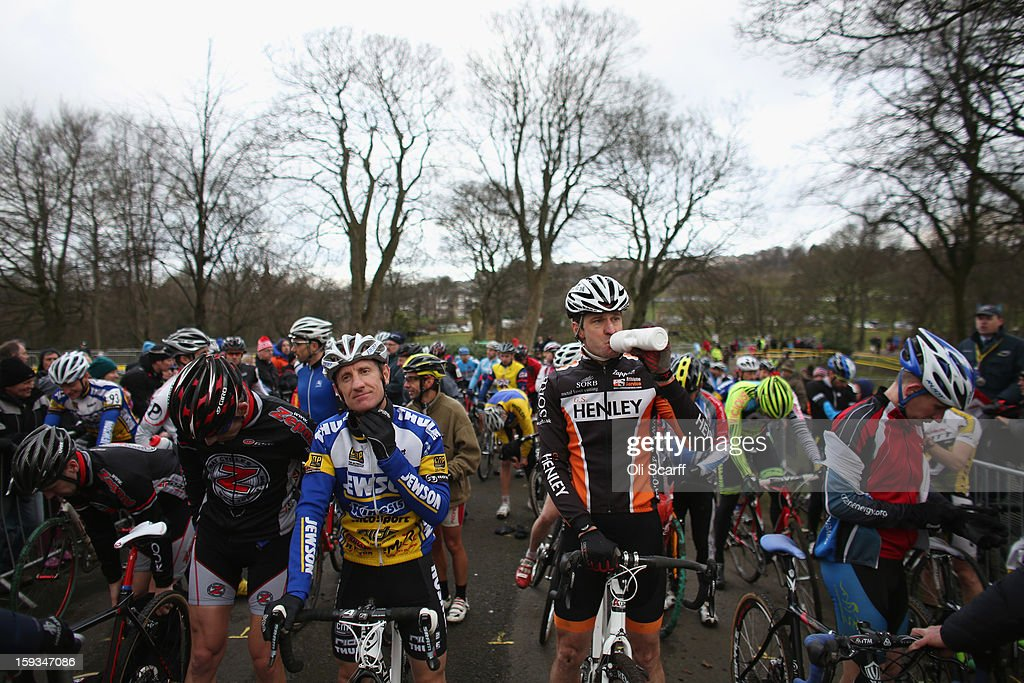 Competitors on the start line in the 'Veteran 40-49 Men' category race at the 2013 National Cyclo-Cross Championships in Peel Park on January 12, 2013 in Bradford, England. The sport of cyclo-cross, featuring lightweight bikes with off-road tyres, has dramatically increased in popularity over the past few years. Cyclo-cross courses are often run over a mixture of terrains from tarmac to mud and frequently include obstacles or steep inclines where riders have to carry their bike.