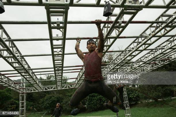 Competitors participate the Monkey Bar task during the Spartan Race AsiaPacific on April 22 2017 in Hong Kong Hong Kong Thousands of competitors from...