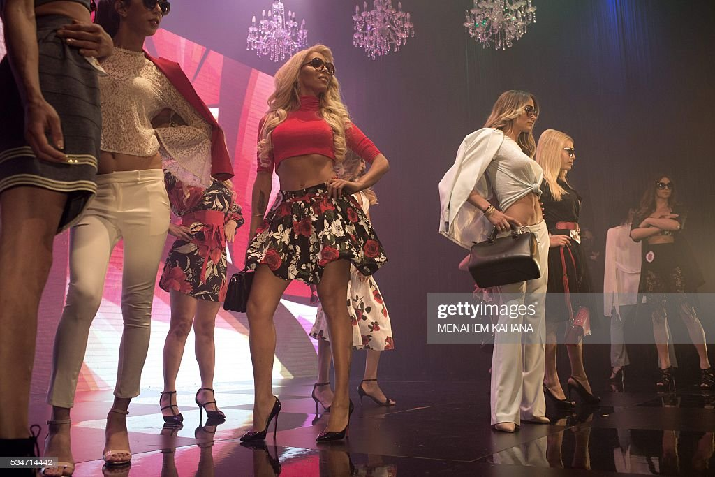 Competitors perform on stage during Israel's first Miss Trans beauty pageant at Habima national theater in Tel Aviv on May 27, 2016, which marks the beginning of the 2016 Pride events. / AFP / MENAHEM