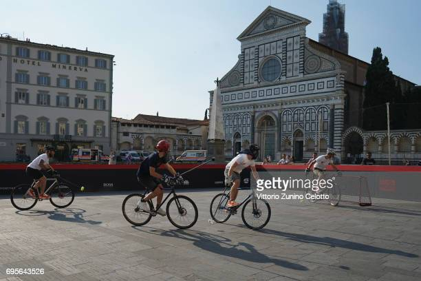 Competitors play during the Christian Louboutin bike polo tournament in Piazza Santa Maria Novella during 92 Pitti Immagine Uomo on June 13 2017 in...
